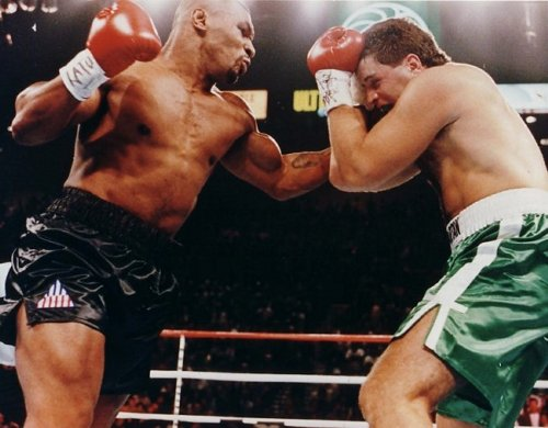 MIKE TYSON THROWS A PUNCH AT PETER McNEELEY