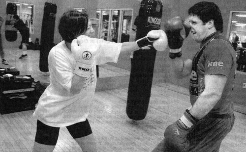 PETER McNEELEY GIVES STUDENT MONA ROSS A LESSON IN COUNTERPUNCHING