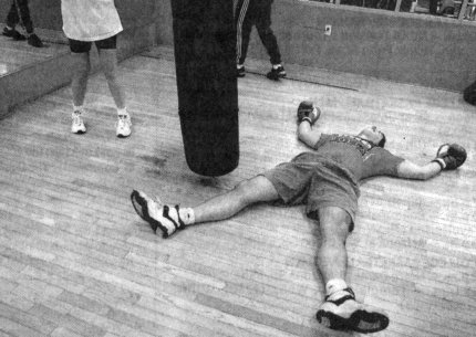 THE PLAYFUL McNEELEY TAKES A DIVE IN HIS BOXING CLASS