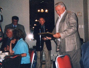 TOM McNEELEY RECEIVES AWARD