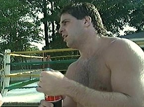 THE REAL THING - PETER McNEELEY COOLS OFF WITH A COKE AFTER WORKOUT