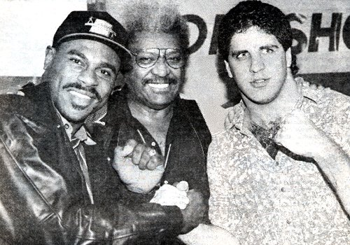 PROMOTER DON KING STANDS BETWEEN HEAVYWEIGHT BOXERS OLIVER McCALL AND PETER McNEELEY