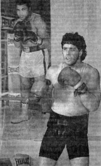 PETER McNEELEY TRAINS IN FRONT OF POSTER OF IDOL ALI