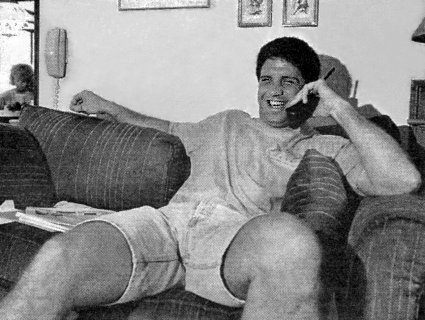 PETER McNEELEY LAUGHS WHILE TALKING ON THE PHONE