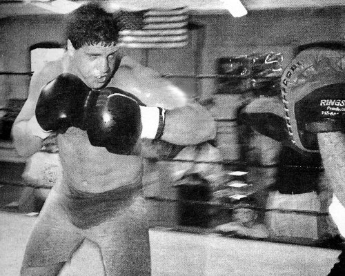PETER McNEELEY WORKS OUT ON THE MITTS