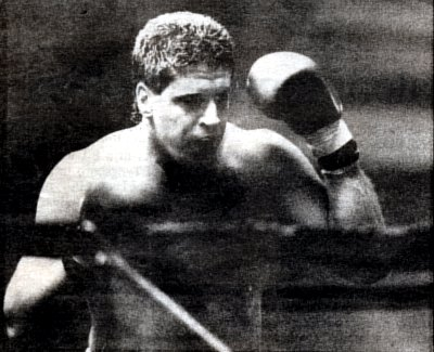 PETER McNEELEY STALKS HIS OPPONENT IN THE RING