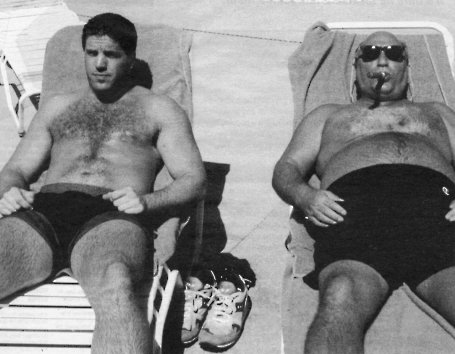 BOXER PETER McNEELEY RELAXES POOLSIDE WITH MANAGER VINNIE VECCHIONE
