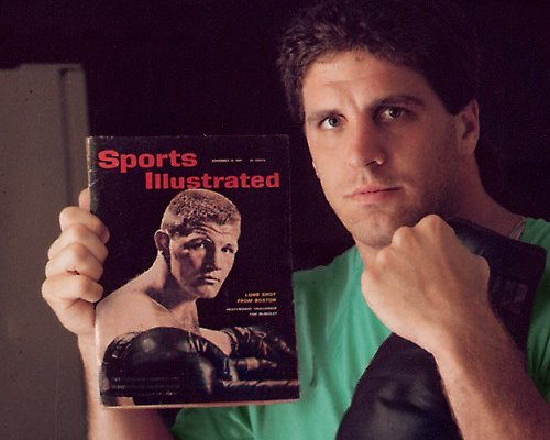 PETER McNEELEY HOLDS SPORTS ILLUSTRATED WITH DAD ON COVER
