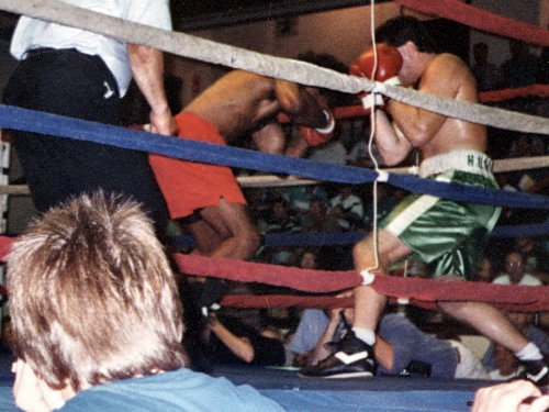 HEAVYWEIGHT BOXER PETER McNEELEY PUMMELS OPPONENT DWAYNE HALL