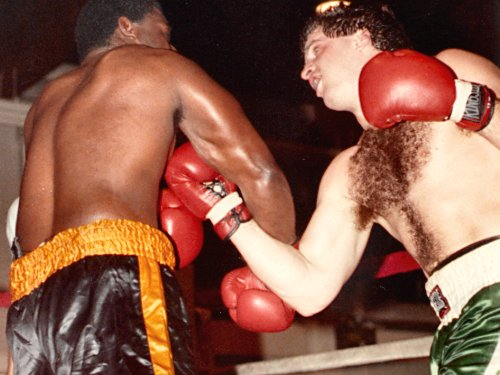 PETER McNEELEY POUNDS OPPONENT J.J. JACKSON IN HEAVYWEIGHT FIGHT