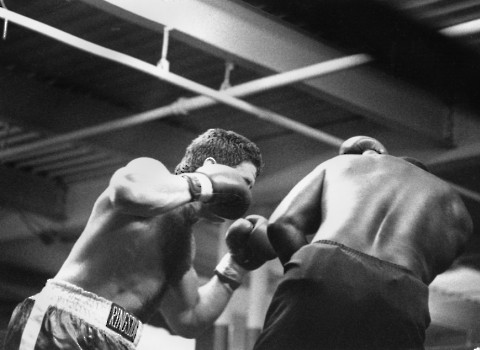 HEAVYWEIGHT BOXER PETER McNEELEY PRESSURES FORMER CHAMPION J.B.WILLIAMSON